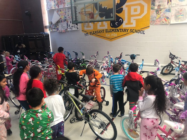 Brady Sullivan Properties gives bicycles to city youth